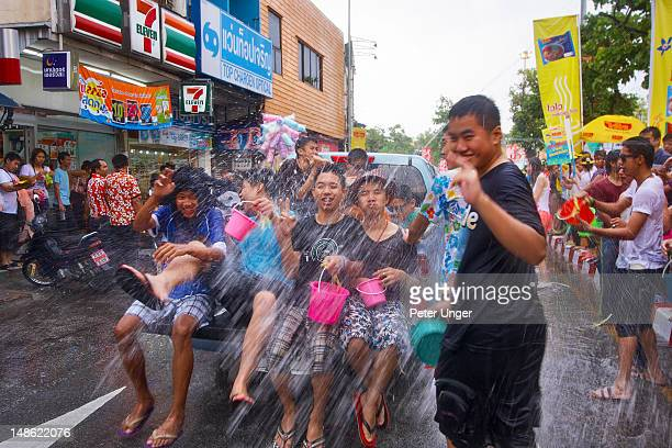 People being doused with water near Tha Pae Gate, Songkran Festival.