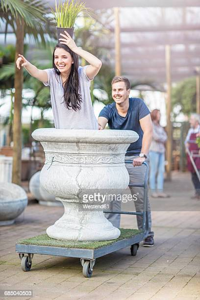 People being silly and having fun at garden centre