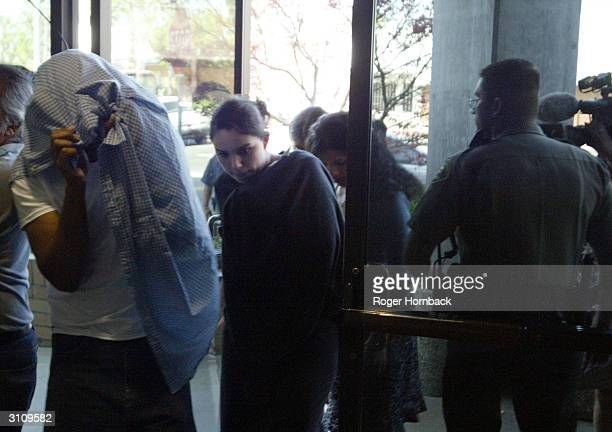 People believed to be family members of Marcus Wesson enter the courthouse on March 18 2004 in Fresno California Wesson's arraignment on nine counts...