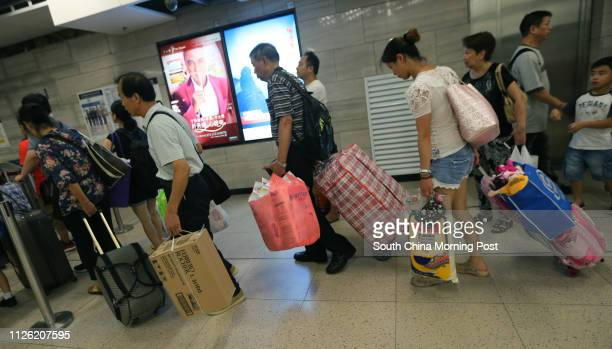 People believed to be parallel traders are seen at Sheung Shui train station 23JUN14