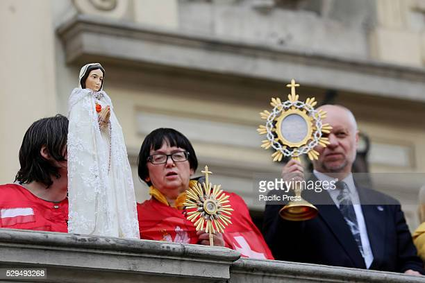 People belonging to a religious organization attempt to 'bless' protesters during a massive demonstration in Warsaw Poland Several hundred thousand...