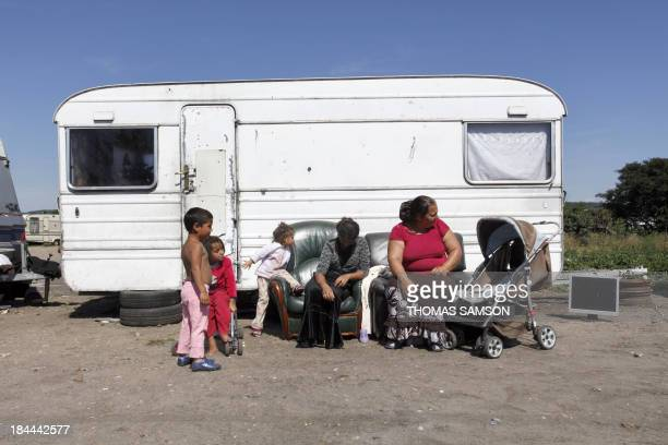 People belonging to the Roma community sit in a camp site on September 1st 2010 in TrielsurSeine Paris suburb France said on August 31 2010 it will...