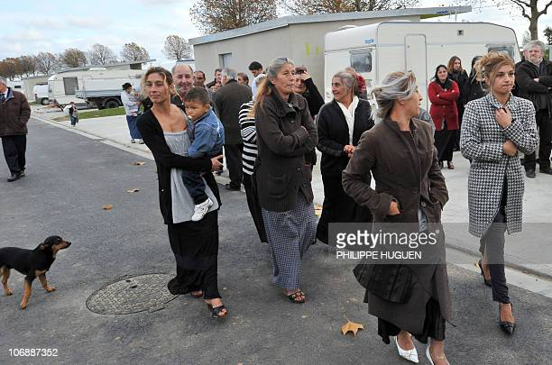 People belonging to the roma community walk in their new settlement during its inauguration on November 8 2010 in QuesnoysurDeule AFP PHOTO PHILIPPE...