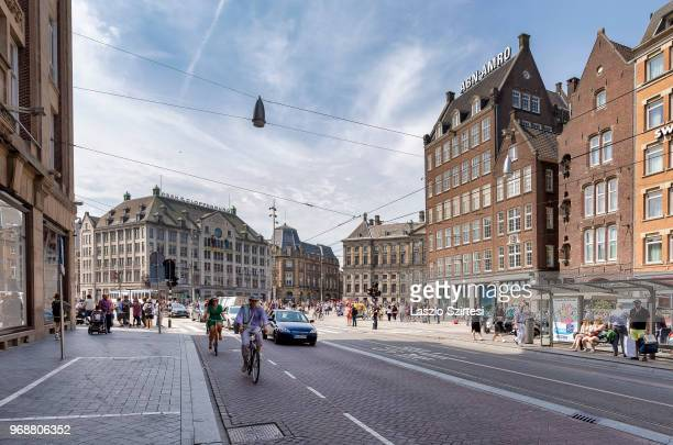 People bike and walk at the intersection of the Damrak Street and Dam Square on May 27 2018 in Amsterdam Netherlands The first day's task of many...