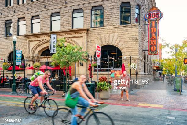people bike in downtown boise idaho usa - idaho stock pictures, royalty-free photos & images