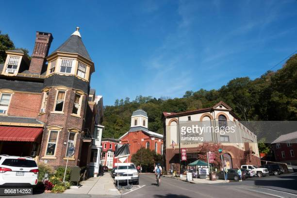 people biking or chatting at opera house square in downtown jim thorpe - jim thorpe pennsylvania stock photos and pictures