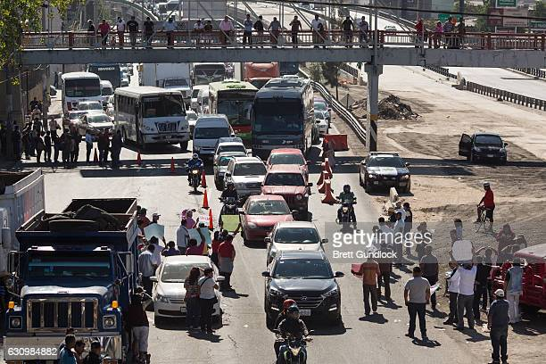 People block a highway leaving Mexico City as a protest to an increase in gas prices on January 4 2017 in Mexico City Mexico On January 1 the Mexican...
