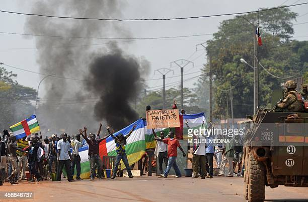 "People block a road as they protest against the French ""Sangaris"" intervention in the Galabadia neighborhood close to the Centrafrican President's..."