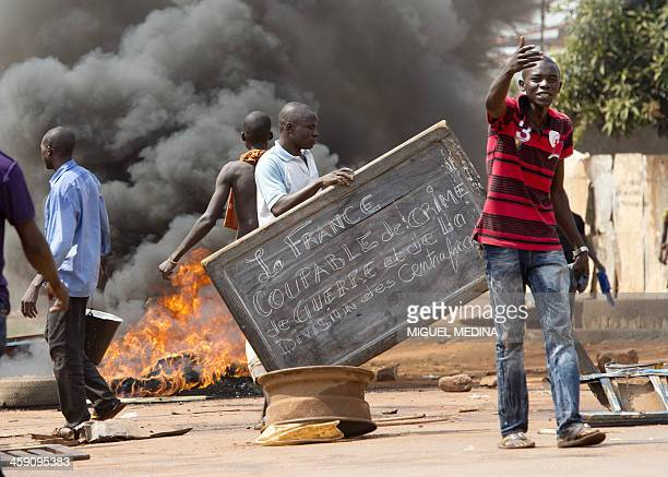 People block a road as they protest against the French Sangaris intervention in the Galabadia neighborhood close to the Centrafrican president's...