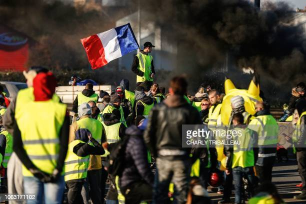 TOPSHOT People block Caen's circular road on November 18 2018 in Caen Normandy on a second day of action a day after a nationwide popular initiated...