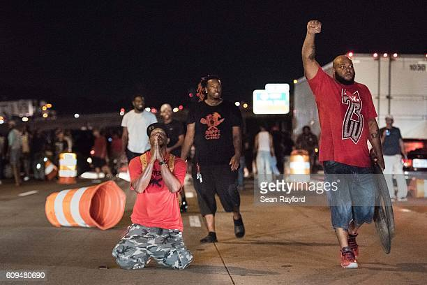 People block traffic on the I85 during protests in the early hours of September 21 2016 in Charlotte North Carolina The protests began last night...