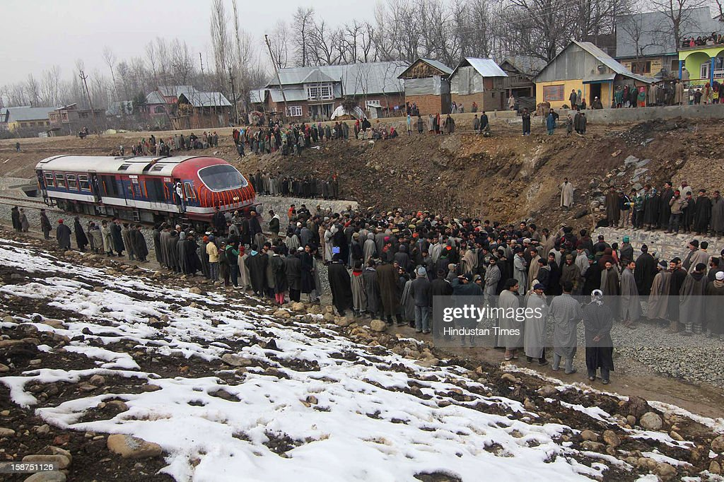 People blocked the Qazigund Banihal train trial, demanding station at village Hillad village on December 27, 2012 in Srinagar, India. Qazigund-Banihal link is the 11.21 km tunnel, longest railway tunnel in India, which will reduce the distance between the two towns by 50 per cent.