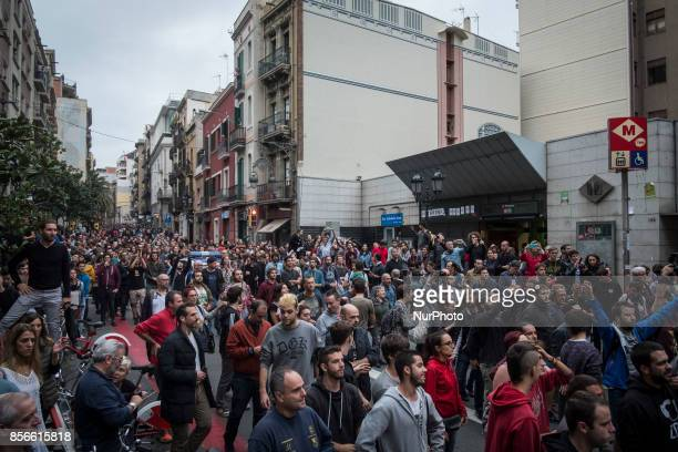 people blocking the streets to prevent any raid from the police in polling station ** More than five million elegible Catalan voters are estimated to...