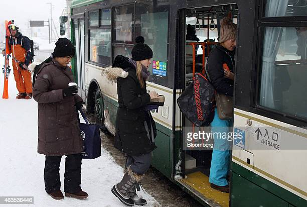People board a bus in the Hirafu area of Kutchan Hokkaido Japan on Saturday Feb 14 2015 Japan had a record number of foreign visitors in 2014...