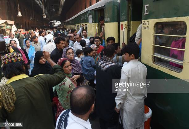 People board a train ahead of the upcoming religious festival Eid ul Adha in railway station in Lahore on August 20 2018 Muslims across the world are...