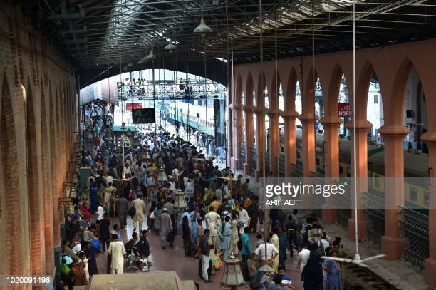 People board a train for the upcoming religious festival Eid ul Adha in railway station in Lahore on August 20 2018 Muslims across the world are...