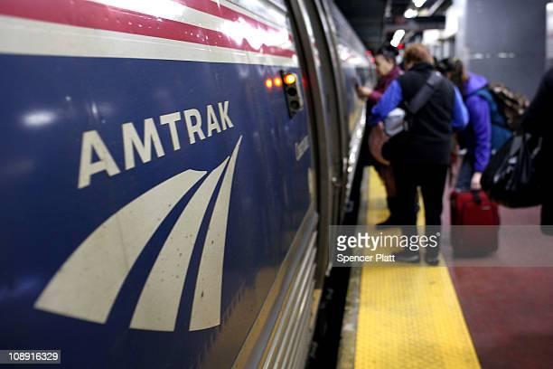People board an Amtrak train at Penn Station on February 8 2011 in New York City Amtrak a governmentowned corporation has joined up with New Jersey's...