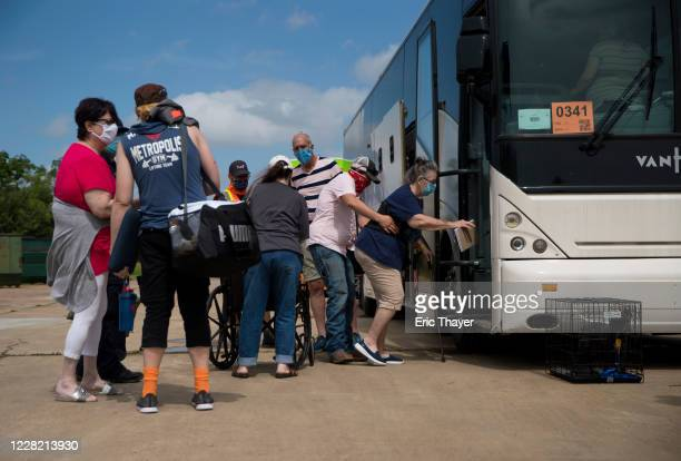 People board buses at the Port Arthur Civic Center to evacuate the city ahead of Hurricane Laura on August 26, 2020 in Port Arthur, Texas. Hurricane...