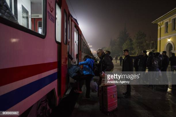 People board the Eastern Express which travels from Ankara to Kars in Ankara Turkey on January 13 2018 With the starting of winter season trekking...