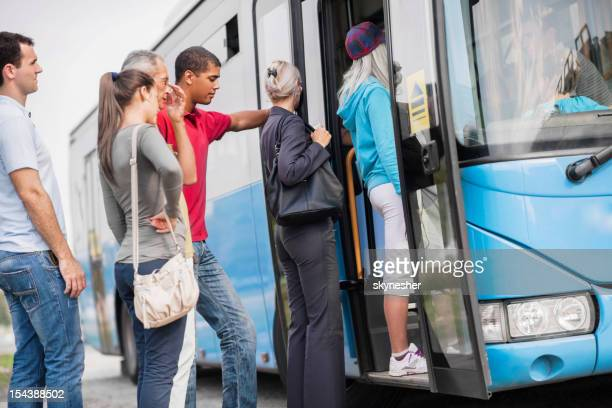 People boarding a bus.