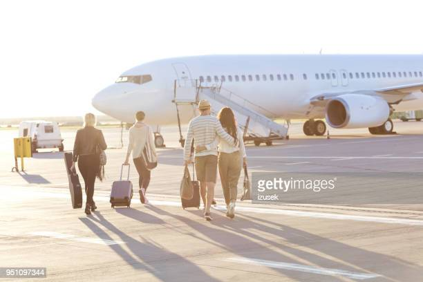 people boarding on the flight - izusek stock pictures, royalty-free photos & images