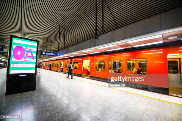 people boarding subway train in helsinki subway, finland - underground stock photos and pictures