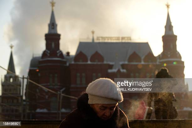 People brave the freezing outdoors in central Moscow on December 18 2012 The temperatures in Moscow dropped today's morning to 20C but due to high...