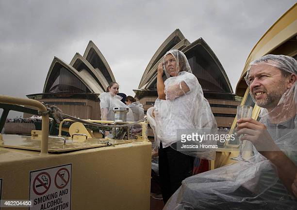 People brave the wet weather to celebrate Australia Day on one of the Sydney's beloved ferries racing from Circular Quay to Shark Island and back to...