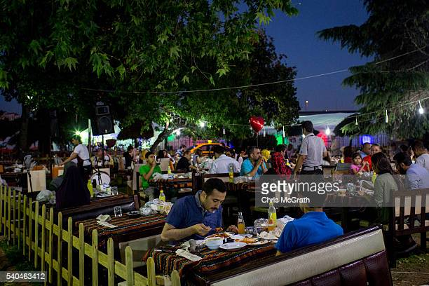 People break fast after evening prayer outside Eyup Mosque during the holy month of Ramadan on June 15 2016 in Istanbul Turkey The holy month of...