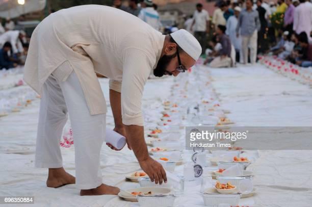 People break their fast during the holy month of Ramadan at Ansari Auditorium in Jamia Milia University on June 15 2017 in New Delhi India Delhi...