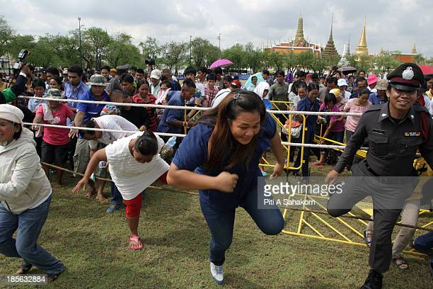 People break through the barriers to collect rice seeds from the annual Royal Ploughing Ceremony at Sanam Luang Thailand's Crown Prince Maha...