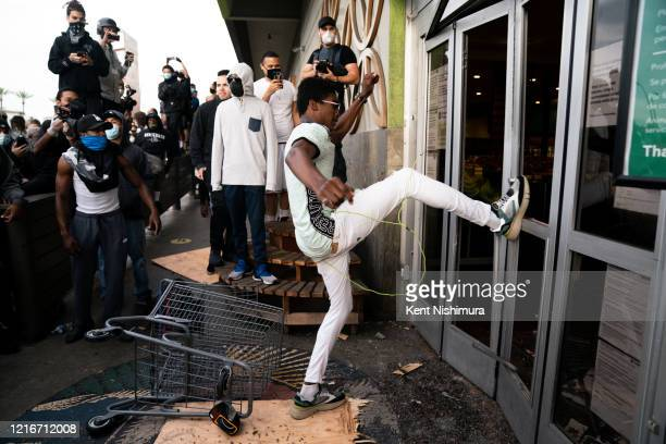 People break thru the door at Whole Foods at Fairfax and 3rd in the Fairfax District on Saturday, May 30, 2020 in Los Angeles, CA. Protests erupted...