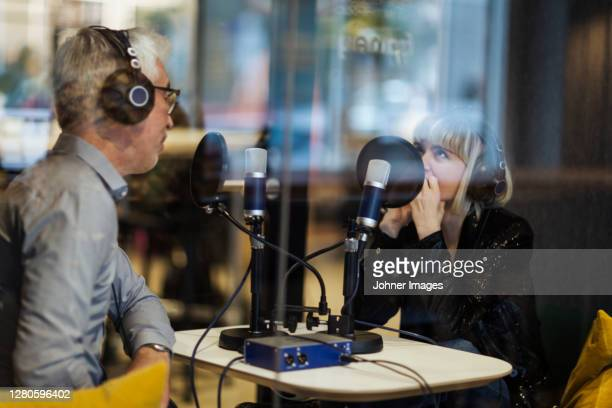 people broadcasting from radio station - broadcasting stock pictures, royalty-free photos & images