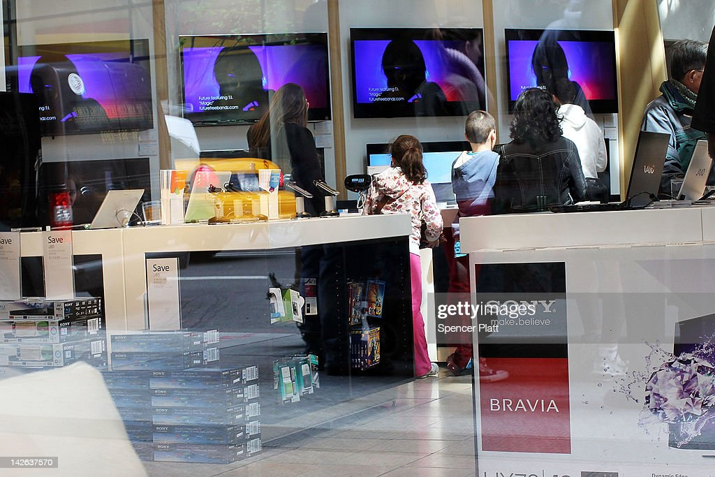 People browse at Sony products at the Sony store on April 10, 2012 in New York City. Sony, the Japanese electronics company, has more than doubled its projected net loss for the past financial year to ´520 billion, the equivalent to $6.4 billion, its worst loss ever.