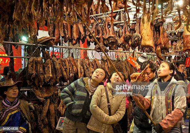 People browse cured and salted meats at a Lunar New Year food fair in Chengdu, China, on Sunday, Jan. 27, 2008. The year of the Rat begins on Feb. 7,...
