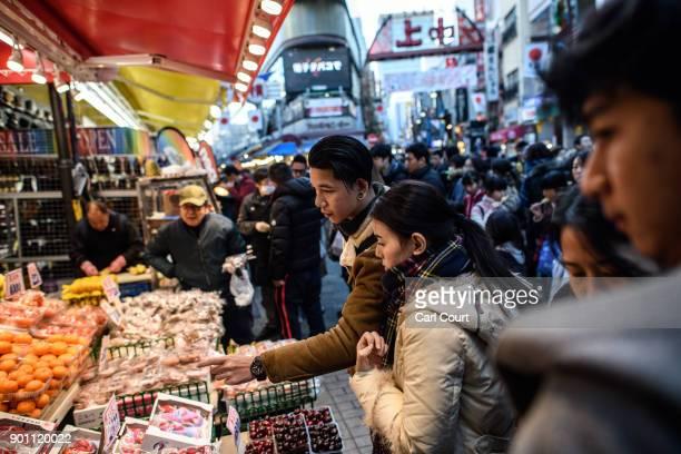People browse items on display at a shop in Ameya Yokocho market on January 4 2018 in Tokyo Japan Ameya Yokocho claimed to be Tokyo's last remaining...