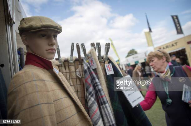 People browse merchandise offered for sale on trade stalls on the second day at the Mitsubishi Motors Badminton Horse Trials on May 4 2017 in...