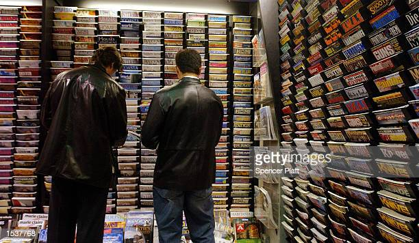 People browse through a variety of publications at a magazine store April 30, 2002 in New York City. Revenues from magazine sales at newsstands has...