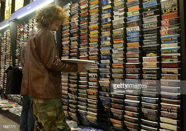 People browse through a variety of publications at a magazine store April 30, 2002 in New York City. Revenue from magazine sales at newsstands has...