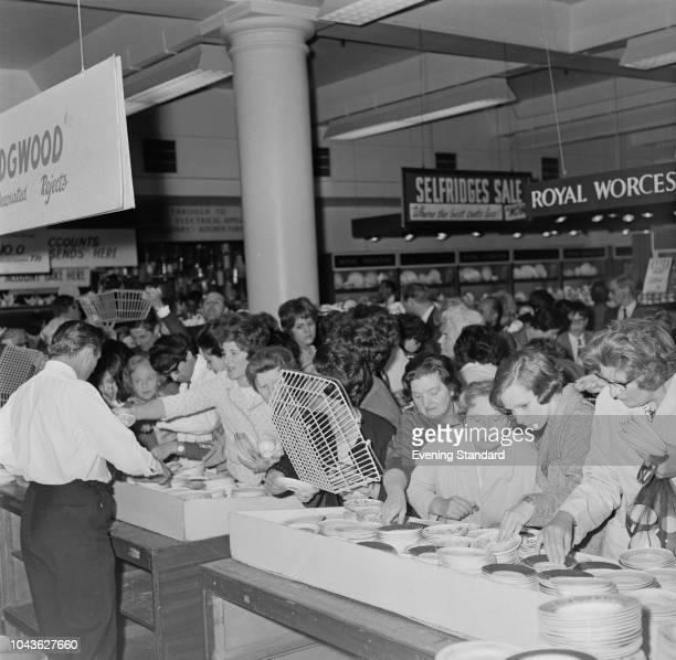 People browsing through kitchenware during sale season at Selfridges, London, UK, 27th June 1968.