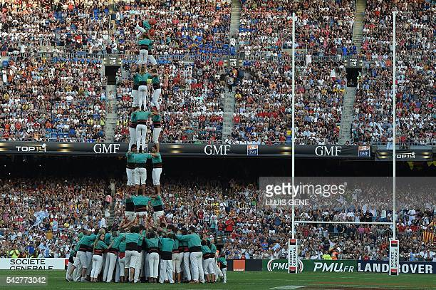People build a Casteller before the French Top14 rugby union final match Toulon vs Racing 92 at the Camp Nou stadium in Barcelona on June 24 2016 /...
