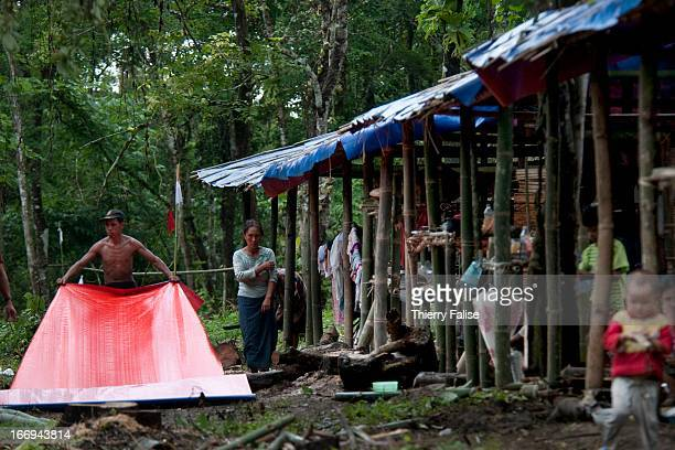 People build houses in a temporary refugee camp Fighting has resumed in June 2011 between the Burmese army and the Kachin Independence Army after 17...