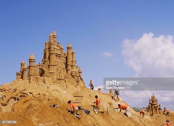 people build sand sculptures inspired by farytales at the Annual Sea Sculpture Festival on June 28 2008 in Middelkerke Belgium