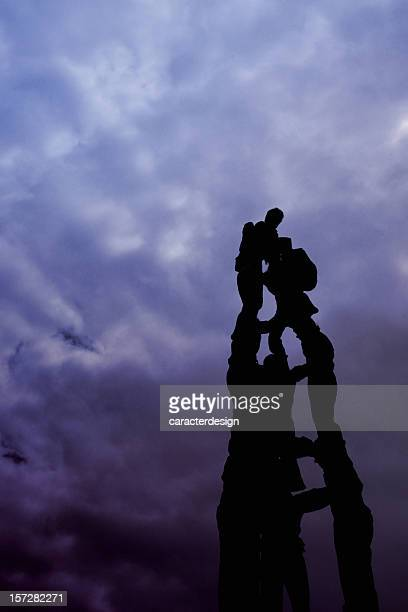 people building a human castle - human pyramid stock photos and pictures