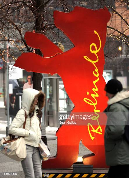 People bundled in winter clothing walk past a Berlinale Bear statue in subzero temperatures ahead of the 60th Berlinale International Film Festival...