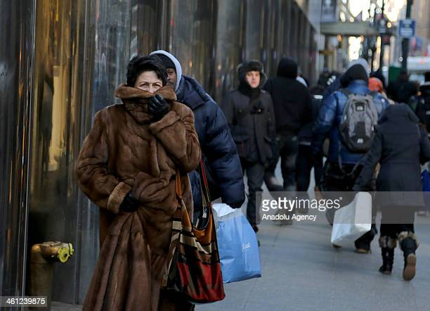People bundling up in their coats walk outside in New York City United States January 7 2014 as Polar Vortex grips United States and Canada Polar...