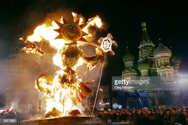 People burn a scarecrow during the Maslenitsa or Shrovetide festivities on Red Square March 9 2003 in Moscow Russia The traditional weeklong Orthodox...