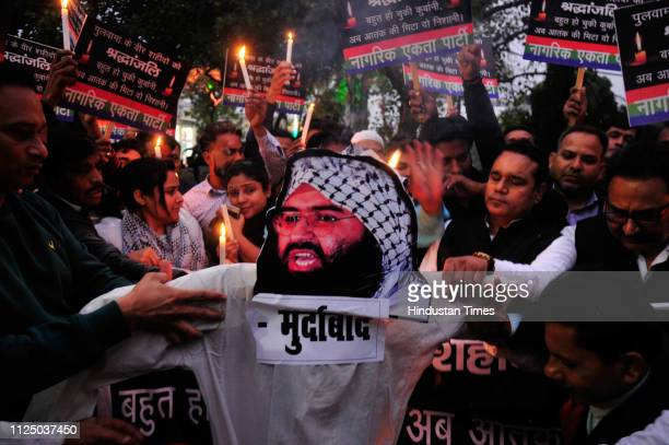 People burn an effigy of JaisheMohammeds leader Masood Azhar after an attack on security forces in Kashmirs Pulwama that left 43 soldiers dead and...