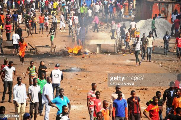 People burn barricades in a street on February 21 in Conakry where at least six people died during violent protests on the eve as people demonstrated...