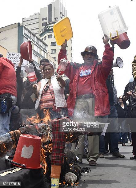 People burn effigies of Economy Minister Luis Arce and Environment and Water Minister Alexandra Moreira as they demand Bolivian President Evo Morales...